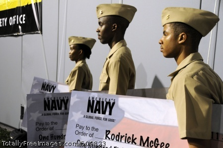 100911-N-4995K-108 MEMPHIS, Tenn. (Sept. 11, 2010) Midshipmen from Vanderbilt University stand by after receiving Naval ROTC  scholarship checks during the 21st annual Southern Heritage Classic. All three Midshipmen are Memphis natives attending Vanderbilt University through the NROTC program. Sailors from across Navy Recruiting District Nashville attended multiple events during the Southern Heritage Classic to foster diversity in recruiting throughout the region.  (U.S. Navy photo by Mass Communication Specialist 2nd Class Chelsea Kennedy/Released)