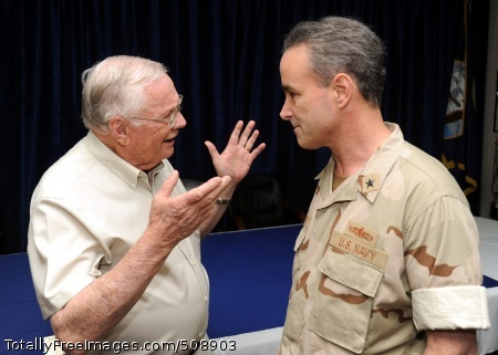 Former astronaut Neil Armstrong talks with Rear Adm. Charles Gaouette, deputy commander of U.S. Naval Forces Central Command, du