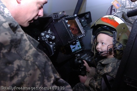 Honorary Staff Sgt. Gaven Cox maneuvers a virtual Apache helicopter on Fort Hood, Texas, March 20. After successfully completing the training he was deemed an honorary gun pilot. As part of the Make-a-Wish Foundation, Cox's wish to become a Soldier was granted.  Photo Credit: Mar 25, 2008