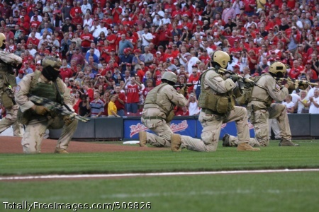 100911-N-3959O-050  CINCINNATI (Sept. 11, 2010) Members of Naval Special Warfare SEAL Team 18 surround the pitcher's mound at Cincinnati's Great American Ballpark before the game between the Pittsburgh Pirates and Cincinnati Reds.  The demonstration consisted of the team entering the ballpark over the outfield fences, encircling the mound, delivering the game ball, and then disappearing through the center field bullpen.  The activities were part of the pre-game ceremonies honoring the victims of the terrorist attack on September 11, 2001. (U.S. Navy photo by Sonar Technician Surface 1st Class Mark O'Loughlin/Released)