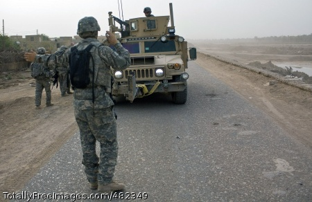 reup Pfc. Jacob McHenry, a forward observer assigned to Co. A, 2nd  Bn., 7th Cav. Regt., 4th BCT, 1st  Cav. Div. guides a Humvee to a tactical parking position off the road in Amarah, Iraq, July 31.  Photo Credit: Aug 19, 2008