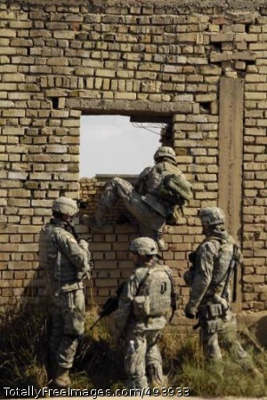 Paratroopers Search Soldiers climb through a wall to get to their next objective.  Photo Credit: Apr 18, 2007