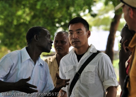 101117-N-7241L-001  TANA DELTA DISTRICT, Kenya (Nov. 17, 2010) U.S. Navy Lt. Perry Choi, right, team leader for Maritime Civil Affairs Team (MCAT) 205, speaks with Samuel Iha, chairman of the Ziwani Primary School Management Committee, before a dedication ceremony for 200 new desks at the school. The Little Creek, Va. based MCAT-205 is deployed to Kenya supporting Combined Joint Task Force - Horn of Africa. (U.S. Navy photo by Mass Communication Specialist 2nd Class Nathan Laird/Released)