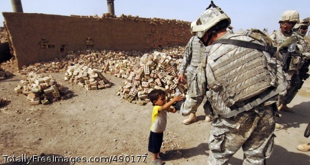 Brick Factory Patrol A Soldier gives an Iraqi boy his bottle of water. Photo Credit: Oct 31, 2007