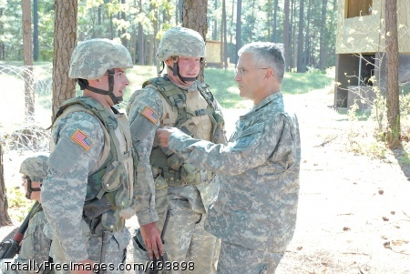 Chief of Staff Gen. George W. Casey Jr., Army chief of staff, talks with Pvt. Scott Yunik (left) and Spc. Matthew Swann, both with Company E, 3rd Battalion, 13th Infantry Regiment, during a visit Tuesday to Omaha Range, Fort Jackson, S.C.Photo Credit: Apr 19, 2007