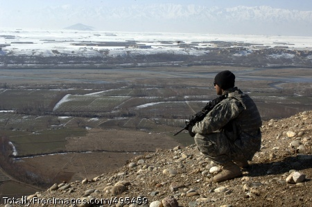 Reform Association Sgt. Munraj Singh, of Bravo Company, 1st Battalion, 102nd Infantry Regiment, looks out over the village of Dingak, Afghanistan, Jan. 3, 2007, while Soldiers with his unit search for possible enemy observation posts and weapons caches. Photo Credit: Jan 16, 2007
