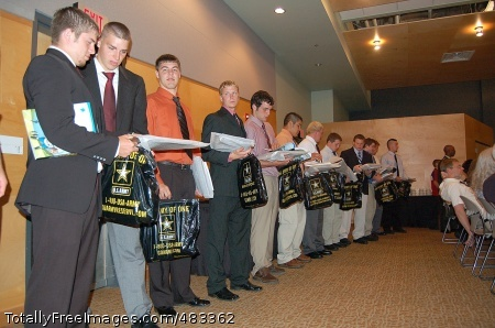 Army Partners with OSHKOSH, Wis. -- Players from the Wisconsin Football Coaches Association All-Star game received Army packages along with their plaques during a banquet July 18 at the University of Wisconsin Oshkosh. Photo Credit: Jul 22, 2008