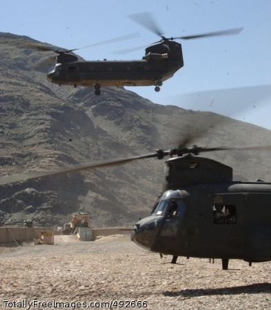Soldiering in CH-47 Chinook helicopters take off after offloading mail and supplies at Forward Operating Base Kalagush. Photo Credit: Jul 5, 2007