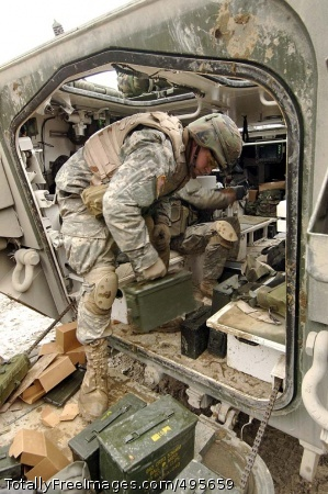 Strykers shift to A Soldier from 3rd Squadron, 2nd Stryker Cavalry Regiment loads ammunition onto his vehicle before entering the attack phase of the unit's platoon-level engagement at Grafenwoehr Training Area. Photo Credit: Dec 26, 2006