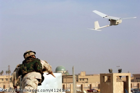 U.S. Army Sgt. Juan Rivera launches a Raven unmanned aerial vehicle into the air over Baghdad, Iraq, on Dec. 15, 2005. The Raven system is used to conduct surveillance in outlying areas in downtown Baghdad. Rivera is assigned to the 1st Battalion, 9th Field Artillery, 3rd Infantry Division.  DoD photo by Pfc. William Servinski II, U.S. Army. (Released) Date: September 20, 2010