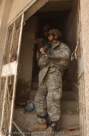 Camaraderie Runs Spc. Jeremy McIntire, an infantryman with 1st Battalion, 38th Infantry Regiment, 4th Brigade Combat Team, 2nd Infantry Division, out of Fort Lewis, Wash., prepares to provide security on a street in the Doura neighborhood of southeastern Baghdad July 19.     Photo Credit: Jul 24, 2007