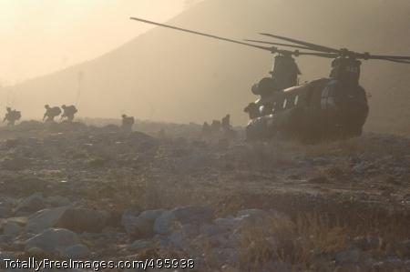 Climbing mountains Soldiers from the 10th Mountain Division (Light Infantry) exit a CH-47 Chinook helicopter Nov. 25, 2006, to conduct a search for weapons caches in Landikheyl, Afghanistan. Photo Credit: Dec 4, 2006