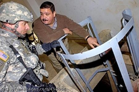 Village Blocks Moshtak Talib Abid, an engineer who maintains the Al Bakr Water Treatment Plant, shows Col. Bryan Owens, commander, 3rd Brigade Combat Team, 82nd Airborne Division, around the plant Nov. 28, 2006, in Al Bakr, Iraq. Photo Credit: Dec 21, 2006