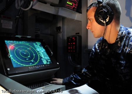 101013-N-8913A-064 ATLANTIC OCEAN (Oct. 13, 2010) Operations Specialist Seaman Bradley S. Pool, assigned to the operations department of the aircraft carrier USS George H.W. Bush (CVN 77), tracks surface vessels by radar inside the ship's navigation plot. George H.W. Bush is underway conducting a Tailored Ship's Training Availability and Final Evaluation Problem. (U.S. Navy photo by Mass Communication Specialist Seaman Leonard Adams/Released)