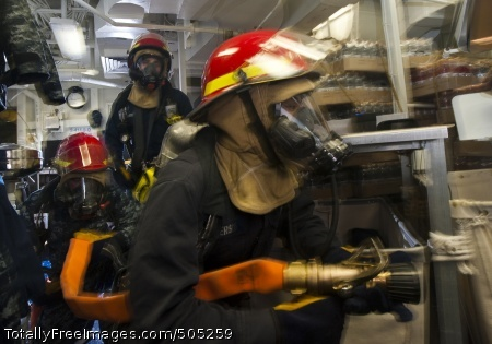 100115-N-7981E-045 PACIFIC OCEAN (Jan. 15, 2011) Engineman 3rd Class Michael Rogers leads a hose team into the ship's laundry to fight a simulated class alpha fire during a flying squad drill aboard the Arleigh Burke-class guided-missile destroyer USS Stockdale (DDG 106). Stockdale is underway with the Carl Vinson Carrier Strike Group on a deployment to the U.S. 7th Fleet area of responsibility. (U.S. Navy photo by Mass Communication Specialist 2nd Class James R. Evans/Released)