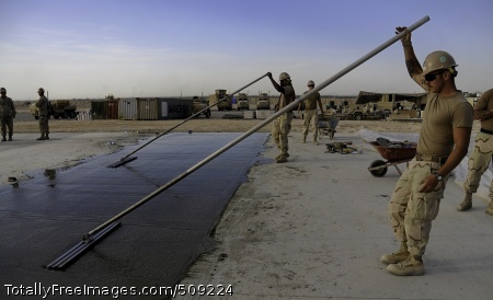 100925-N-6436W-021 DEH DADI II, Afghanistan (Sept. 25, 2010) Seabees assigned to Naval Mobile Construction Battalion (NMCB) 40 place concrete for a project at Camp Deh Dadi II, Afghanistan. (U.S. Navy photo by Chief Mass Communication Specialist Michael B. Watkins/Released)