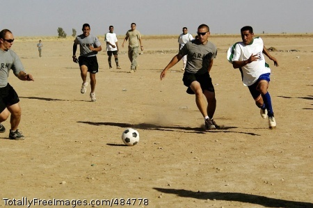 Iraq soccer game Soccer Warriors of 1st Battalion, 87th Infantry Regiment, scramble for a loose ball Thursday on a dusty field near Mahus in the Hawijah District of the Kirkuk Province, Iraq. Photo Credit: Jun 16, 2008