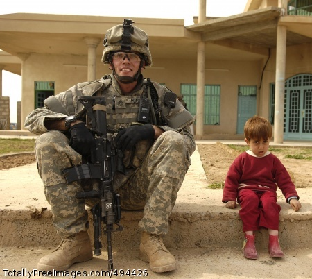 Resting a Spell Staff Sgt. Christopher Pearce sits beside an Iraqi boy during a visit to a sheik's house in Riyahd, March 8. Pearce is from the 3rd Brigade Combat Team, 25th Infantry Division. Photo Credit: Mar 16, 2007