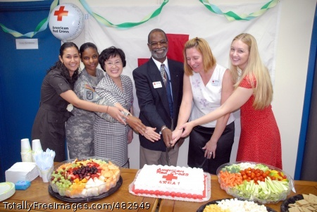 American Red Cross Celebrating the July 16 opening of the USAG-Red Cloud ARC building with a cake cutting ceremony are (from left) Kristina Bonic, American Red Cross; USAG-RC Command Sgt. Maj. Earlene Lavender; Mr. Kim, Jeong-Young, Korean Red Cross representative; Lawson Hughes, ARC regional manager; Deanna Young, USAG-RC ARC station manager; and Libby Worman, USAG-RC ARC assistant station manager.  http://ima.korea.army.mil/area1/sites/local/ Photo Credit: Jul 31, 2008