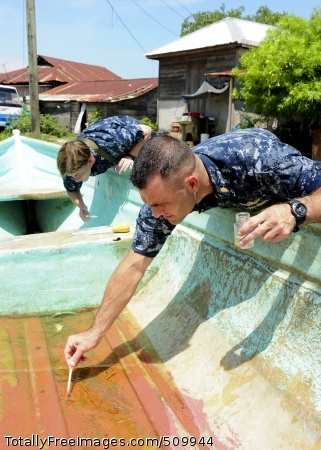 100910-N-1531D-099 PUERTO BARRIOS, Guatemala (Sept. 10, 2010) Lt. Michael Kavanaugh, front, Preventive Medicine entomologist, from Jenks, Okla., and Hospital Corpsman 1st Class Robyn Murillo, from Lebanon, Mo., take water samples from a boat during their tour of looking for contaminated water in Puerto Barrios, Guatemala. The multi-purpose amphibious assault ship USS Iwo Jima (LHD 7) is anchored off the coast of Guatemala conducting Continuing Promise 2010, a humanitarian and civic assistance mission. The assigned medical and engineering staff embarked aboard Iwo Jima are working with partner nation teams to provide medical, dental, veterinary and engineering assistance to eight different nations. (U.S. Navy photo by Mass Communication Specialist 2nd Class Jonathen E. Davis/Released)