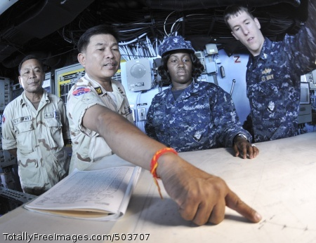 110227-N-9950J-063 GULF OF THAILAND (Feb. 27, 2011) Royal Cambodian Navy Cmdr. In Sokhemra points out a course on the chart table during a tour of the forward-deployed amphibious assault ship USS Essex (LHD 2). Essex is part of the Essex Amphibious Ready Group and is participating in Cambodian Maritime Exercise 2011. (U.S. Navy photo by Mass Communication Specialist 2nd Class Greg Johnson/Released)