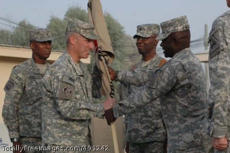 U.S. National Army Col. Richard L. Stevens, outgoing commander Regional Command (South) U.S. National Command Element, accepts the colors from Army Command Sgt. Maj. Willie Williams to pass to Army Col. Pat Crowder, incoming commander RC (S) U.S. NCE at a change of command ceremony at Kandahar Airfield, Afghanistan, Sept. 24.  Photo Credit: Sep 26, 2007