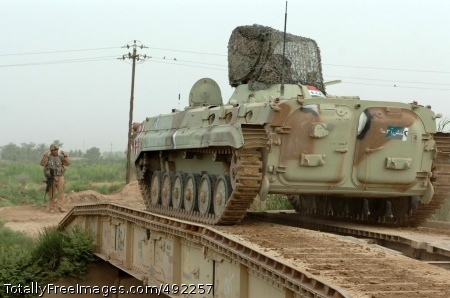 Sappers Rule the A U.S. Soldier directs an Iraqi infantry fighting vehicle (Soviet-era beovaya mashina podderzhki or BMP) over a mobile bridge built by the sappers. Photo Credit: Aug 1, 2007