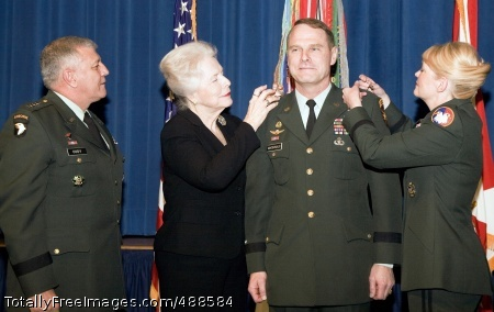 2nd Star Maj. Gen. John Macdonald receives his second star from his mother, Martha Macdonald, second from left, and his wife, Brig. Gen. Anne Macdonald, right, during a promotion ceremony Jan. 11 at the Pentagon. Gen. Richard A. Cody, left, vice chief of staff of the Army, hosted the promotion ceremony. Maj. Gen. Macdonald is the commanding general of the Family and Morale, Welfare and Recreation Command in Alexandria, Va., and deputy commanding general of the U.S. Army Installation Management Command in Arlington, Va., and Brig. Gen. Macdonald is chief of staff of the U.S. Army Reserve Command at Fort McPherson, Ga. Photo Credit: Jan 15, 2008
