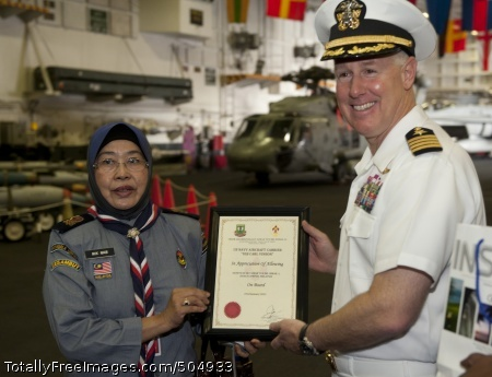 110123-N-7981E-194 PORT KLANG, Malaysia (Jan. 23, 2011) Capt. Bruce Lindsey, commanding officer of the Nimitz-class aircraft carrier USS Carl Vinson (CVN 70), accepts a certificate of appreciation from headmistress Nik Nab and scouts from SK Taman Tun Dr. Ismail 1KL High Performance School during a tour of the ship while moored in Port Klang, Malaysia. Carl Vinson and Carrier Air Wing (CVW) 17 are on a deployment to the U.S. 7th Fleet area of responsibility. (U.S. Navy photo by Mass Communication Specialist 2nd Class James R. Evans/Released)