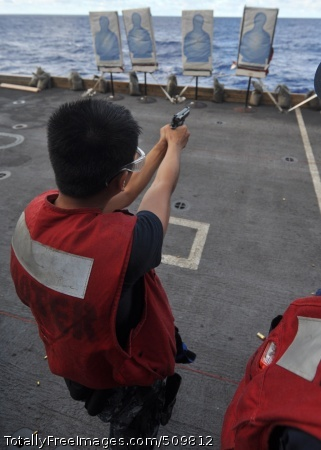 100914-N-2013O-038  PACIFIC OCEAN (Sept. 14, 2010) Interior Communications Electrician 3rd Class Kyle Adona, from Vallejo, Calif., fires an M-9 pistol during a small-arms live-fire exercise aboard the aircraft carrier USS George Washington (CVN 73). George Washington, the Navy's only permanently forward-deployed aircraft carrier, is underway helping to ensure security and stability in the Western Pacific Ocean. (U.S. Navy photo by Mass Communication Specialist 3rd Class Charles Oki/Released)