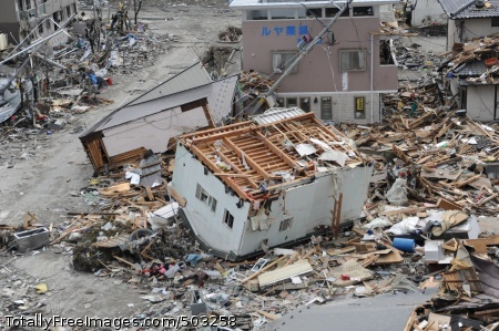 110315-N-2653B-107 OFUNATO, Japan (March 15, 2011) An upended house is among debris in Ofunato, Japan, following a 9.0 magnitude earthquake and subsequent tsunami. (U.S. Navy photo by Mass Communication Specialist 1st Class Matthew M. Bradley/Released)