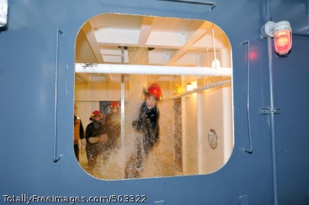 110310-N-IK959-126 GREAT LAKES, Ill. (March 10, 2011) Midshipman 1st Class Angela Odom, from the University of Memphis Naval ROTC, attempts to egress from a flooding shipboard compartment in the Wet Trainer of the Damage Control A School. The 18 midshipmen participated in Navy training and toured Recruit Training Command. (U.S. Navy photo by Scott A. Thornbloom/Released)