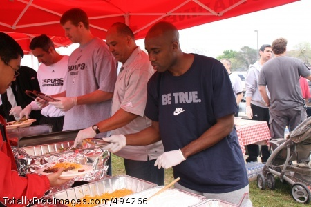 Spurs Serve Wounded Spurs guard Jacque Vaughn and forward Matt Bonner 'dish' up points with fans in the serving line of a barbecue sponsored by the Y.O. Ranch.  Photo Credit: Mar 28, 2007