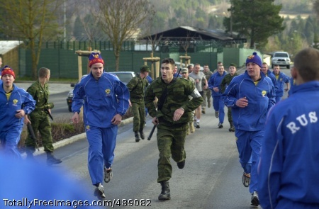 'Torgau' Exercise U.S. and Russian Soldiers in physical training gear cheer on their comrades in uniform headed for the finish line of the run and shoot competition that was part of Dec. 8 'cultural day' activities during the 2007 Torgau exercise at the Hohenfels (Germany) Training Area. The event required participants to run two miles, fire M16 rifles on a live range, and then run two miles back to the start point. The two-week U.S.-Russian exercise includes combined basic infantry skills training and a command post exercise, and will culminate in a combined live-fire exercise.  Photo Credit: Dec 14, 2007