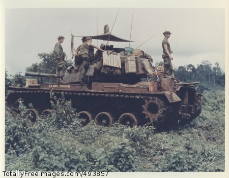 Men of Troop B Men of Troop B, 1st Battalion, 10th Cavalry Regiment, 4th Infantry Division, and their M-48 Patton tank move through the jungle in the Central Highlands of Vietnam, June 1969. Source: Vietnam Photos Miscellaneous Collection. Photo Credit: Apr 22, 2007