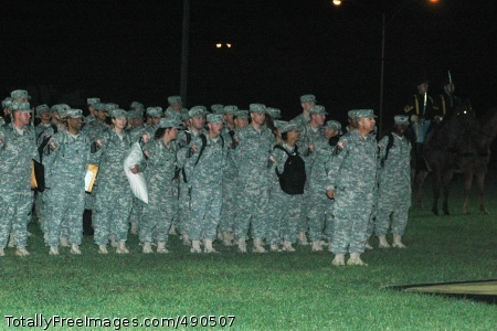 Approximately 70 1st Cavalry Division troopers wait to be released to their eager family members on Fort Hood's Cooper Field during a late night welcome home ceremony Oct. 15. These troopers, from the division's Band and the 15th Sustainment Brigade's Detachment B, 15th Personnel Services Battalion, returned to Fort Hood after more than a year in Iraq.  Photo Credit: Oct 17, 2007