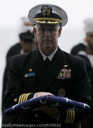 101227-N-2055M-488 PACIFIC OCEAN (Dec. 27, 2010) Capt. Bruce H. Lindsey, commanding officer aboard the aircraft carrier USS Carl Vinson (CVN 70), walks with the national ensign during a burial at sea. Carl Vinson and Carrier Air Wing (CVW) 17 are on a deployment to the U.S. 7th and U.S. 5th Fleet areas of responsibility. (U.S. Navy photo by Mass Communication Specialist 3rd Class Travis K. Mendoza/Released)