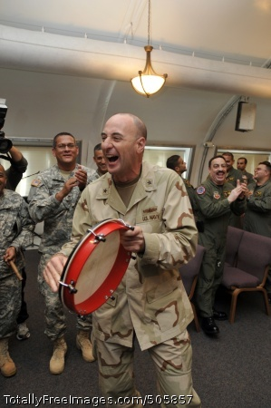 101220-N-3887D-106 GUANTANAMO BAY, Cuba (Dec. 22, 2010) Rear Adm. Jeffery Harbeson, commanding officer of Joint Task Force Guantanamo, taps a tambourine during a musical performance with Soldiers from the Puerto Rico Army National Guard. Maj. Gen Antonio Vicens and members of the Puerto Rico Army National Guard Recruiting and Recreation Battalion visited Soldiers assigned to Company B, 1st Battalion, 296th Infantry Regiment to show support for the deployed Soldiers during the holiday season.  (U.S. Navy photo by Mass Communication Specialist 2nd Class Elisha Dawkins/Released)