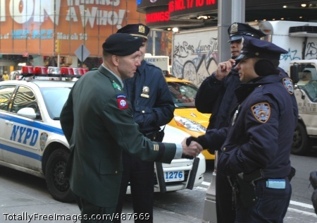 Lt. Gen. Caldwell Members of the NYPD are greeted by Lt. Gen. William B. Caldwell IV, commanding general, Combined Arms Center and Fort Leavenworth, KS, during his visit to the Times Square Military Recruiting Station in New York City March 10. 