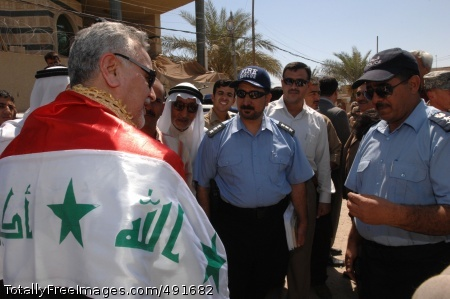 Fallujah on foot Iraqi Vice President Tariq al-Hashimi talks to Fallujah policemen during a visit to the city with Gen. David H. Petraeus. The policemen and local sheiks greeted Hashimi with their country's flag, wrapping it around his shoulders. Photo Credit: Sep 23, 2007