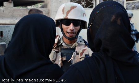 Program Integrates Sgt. Yasser Ahmed talks with local women during a patrol in the Graya'at area of Baghdad's Adhamiyah District Sept. 5.  Photo Credit: Sep 20, 2007