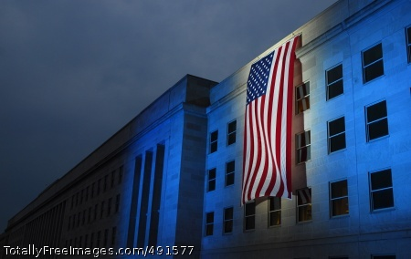 Illuminated 9/11 A memorial flag is illuminated, Sept. 11, 2007, near the spot where American Airlines Flight 77 crashed into the Pentagon six years ago. Defense Secretary Robert Gates will host a Pentagon Sept. 11 Memorial observance today. Photo Credit: Sep 11, 2007