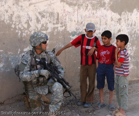 East Baghdad Patrol Staff Sgt. Robert Montez chats with local children during a patrol through the Mashtal neighborhood. Photo Credit: Apr 17, 2007