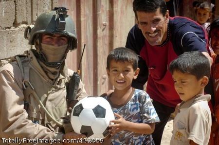Soccer Ball An Iraqi Soldier gives soccer balls to children in Fallujah. Photo Credit: Jul 5, 2007
