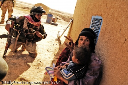 Air Assault Mission An Iraqi soldier questions a villager after finding .50-caliber armor piercing rounds in the area. Photo Credit: Dec 3, 2007