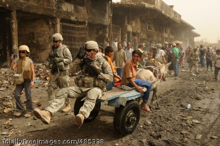 Hitching a Ride A Soldier gets a lift from an Iraqi boy and his mule on Route Douglas in the Jameela Market, the Sadr City district of Baghdad. Photo Credit: Jun 9, 2008
