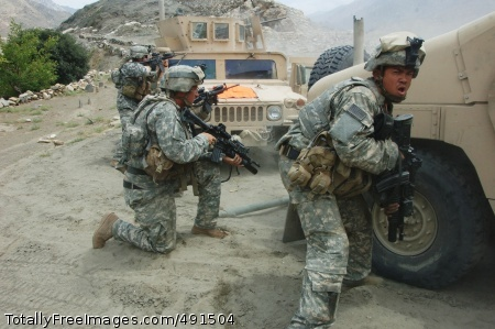 Counterattack at Soldiers use their vehicles as cover during the firefight. Photo Credit: Sep 14, 2007