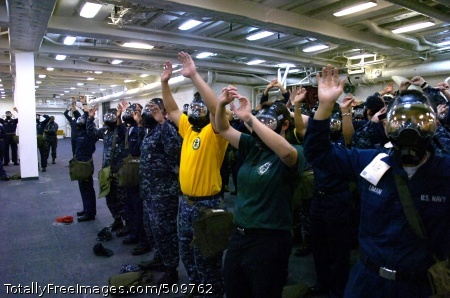 100914-N-2515C-097 SAN DIEGO (Sept. 14, 2010) Sailors raise their arms, signifying that they have successfully donned their MCU-2P gas mask during chemical, biological, and radiological (CBR) training aboard the amphibious transport dock USS Green Bay (LPD 20). The CBR training was held in preparation for the upcoming Unit-Level Training Assessment-Certification (Ultra-C). (U.S. Navy photo by Mass Communication Specialist 1st Class Larry S. Carlson/Released)