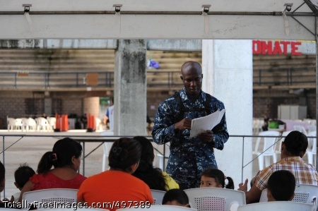 110719-F-ET173-022 ACAJUTLA, El Salvador (July 19, 2011) Hospitalman Agustus Lartey, from Ghana, reviews forms of patients waiting to receive medical treatment during a Continuing Promise 2011 community service medical event at the Polideportivo medical site. Continuing Promise is a five-month humanitarian assistance mission to the Caribbean, Central and South America. (U.S. Air Force photo by Staff Sgt. Alesia Goosic/Released)