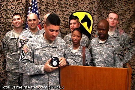 Magic 8-ball Long Island, N.Y., native Lt. Col. Daniel Garcia, commander of the 1st Cavalry Division's Special Troops Battalion, 'consults' with his trusted advisor, his 'Magic 8-Ball' at the conclusion of a question and answer session with his battalion's rear detachment and Family Readiness Group via satellite from the Media Operations Center at Camp Liberty in western Baghdad Sept. 19.  More than 150 Soldiers and Family members met for the live satellite meeting at the Fort Hood Catering and Conference Center.  The 6:30 p.m. start time in central Texas brought Garcia and his company commanders to the media center early in the morning, 3:30 a.m., to meet and discuss redeployment issues with the Families of Soldiers serving within the DSTB.   Photo Credit: Sep 19, 2007